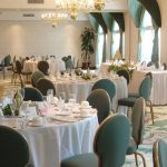 banquet room with green chairs and white table cloths at Best Western Plus The Inn at Hampton